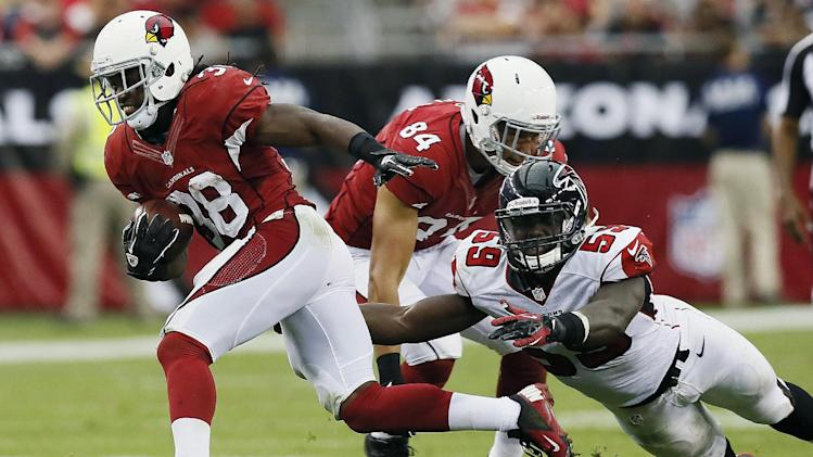 Arizona Cardinals' Andre Ellington, left, gets past Atlanta Falcons' Joplo Bartu (59) as Cardinals' Rob Housler blocks during the second half of an NFL football game on Sunday, Oct. 27, 2013, in Glendale, Ariz. The Cardinals won 27-13