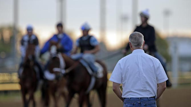 Trainer Todd Pletcher watches horses during a morning workout at Churchill Downs Thursday, May 2, 2013, in Louisville, Ky. (AP Photo/Charlie Riedel)