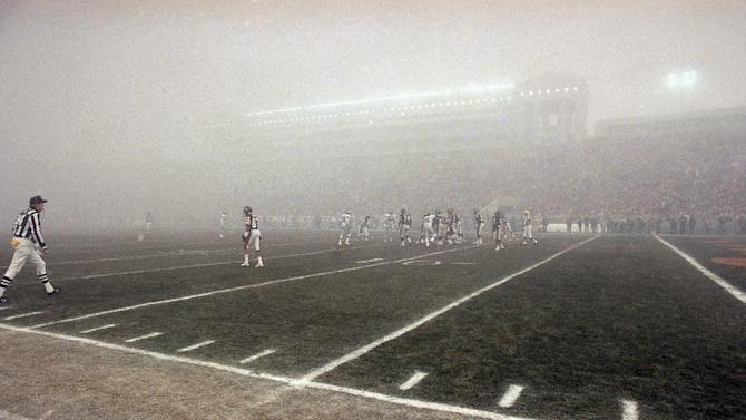 FILE - In this Dec. 31, 1988, file photo, lights shine through the fog during an NFL football playoff game between the Chicago Bears and the Philadelphia Eagles in Chicago. (AP Photo/File)