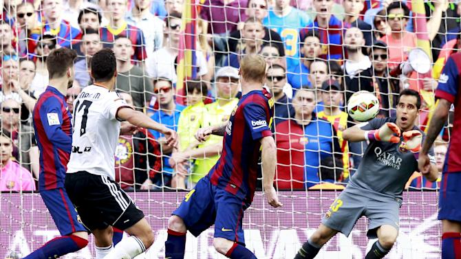 Barcelona's goalkeeper Claudio Bravo blocks the ball during their Spanish first division soccer match against Valencia at Nou Camp stadium in Barcelona
