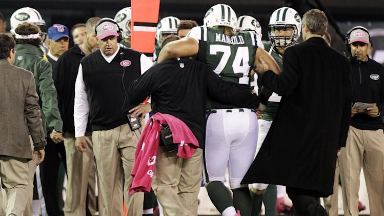 New York Jets head coach Rex Ryan watches as trainers help Nick Mangold (74) off the field during the second half of an NFL football game against the Houston Texans, Monday, Oct. 8, 2012, in East Rutherford, N.J. (AP Photo/Kathy Willens)