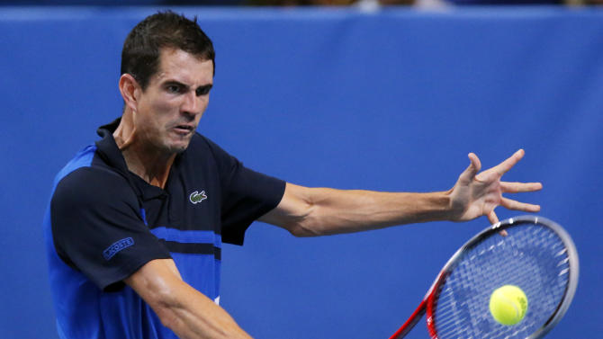 Guillermo Garcia-Lopez of Spain returns the ball to Joao Sousa of Portugal during the St. Petersburg Open ATP tennis tournament semi final match in St.Petersburg, Russia, Saturday, Sept. 21, 2013. (AP Photo/Dmitry Lovetsky)