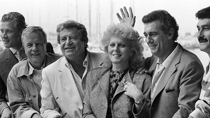 "FILE - In this May 15, 1986 file photo, from left, Italian film director Franco Zeffirelli, Israeli Producer Menahem Golan, opera singer Katia Ricciarelli and Mexican Singer Placido Domingo in Cannes, for the screening of their film ""Otello"" in competition in the 39th Cannes film festival. Golan, a veteran Israeli filmmaker who produced some of the biggest action movies of the 1980s, has died in Tel Aviv. He was 85. (AP Photo/Michel Lipchitz, File)"