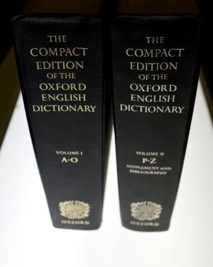 "FILE - In this Aug. 29, 2010 file photo, an Oxford English Dictionary is shown at the headquarters of The Associated Press in New York. A report that Oxford University had changed its comma rule left some punctuation obsessives alarmed, annoyed, and distraught. Passions subsided as the university said the news was imprecise, incomplete and misleading. Oxford University Press, birthplace of the Oxford comma, said Thursday, June 30, 2011, that there has been no change in its century-old style, and jumped into the Twittersphere to confirm that it still follows the standard set out in ""New Hart's Rules.""  (AP Photo/Caleb Jones)"