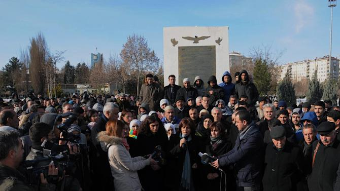 """Several hundreds Turkish Kurds gather to protest the killings of three Kurdish women, including one of the founders of a militant group battling Turkish troops since 1984 in Paris, France, in the southeastern Turkish city of Diyarbakir, Turkey, Thursday, Jan. 10, 2013. The three women were """"executed"""" at a Kurdish center in Paris, French Interior minister Manuel Valls said Thursday.(AP Photo)"""