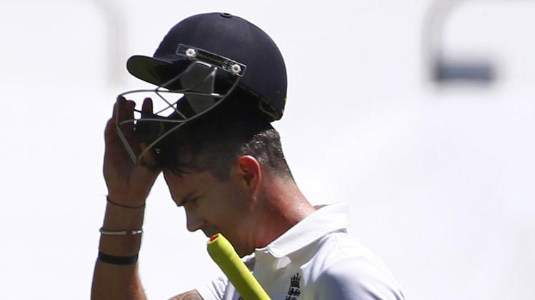 England's Pietersen removes his helmet as he walks off the field after his dismissal by Australia's Peter Siddle during the third day of the second Ashes test cricket match in Adelaide