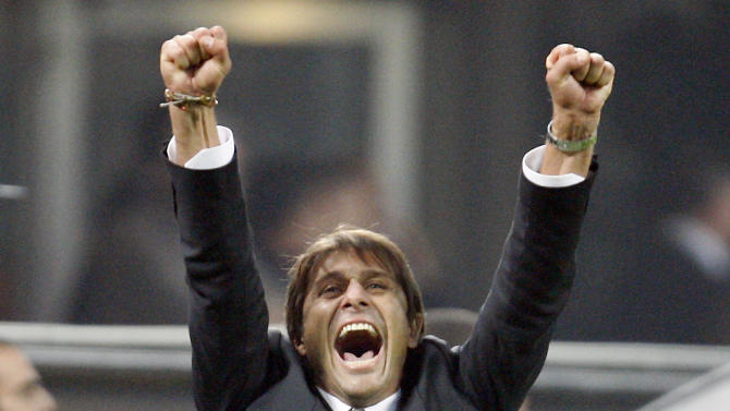 FILE -- In this Oct. 29, 2011 file photo, Juventus coach Antonio Conte celebrates after winning the Serie A soccer match between Inter Milan and Juventus at the San Siro stadium in Milan, Italy.  Coach of Italian champion Juventus, Antonio Conte, was placed under investigation on Monday, May 28, 2012, for alleged wrongdoing while coach of Siena. Italian authorities swept through the Italy national team training site near Florence and made more than a dozen arrests elsewhere Monday as part of a wide-ranging investigation into match-fixing in football. News reports said Lazio captain Stefano Mauri was among those arrested. Police are also investigating Italy and Zenit St Petersburg defender Domenico Criscito a week before the national team leaves for the European Championship in Poland and Ukraine. (AP Photo/Antonio Calanni)