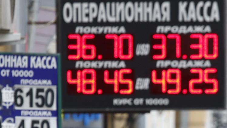 Boards displaying currency exchange rates are on display in central Moscow