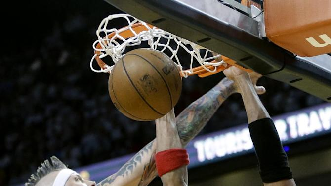 Chicago Bulls forward Taj Gibson (22) dunks against Miami Heat forward Chris Andersen (11) during the second half of Game 1 of the NBA basketball playoff series in the Eastern Conference semifinals, Monday, May 6, 2013 in Miami. The Bulls defeated the Heat 93-86. (AP Photo/Lynne Sladky)