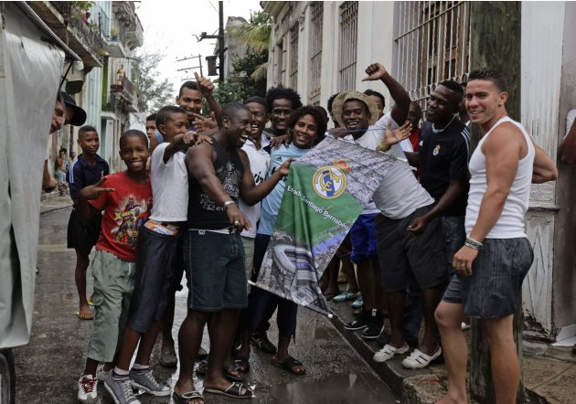 Cuban Real Madrid supporters celebrate Real's victory over Barcelona, on a street in Havana