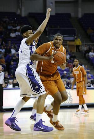 Holmes carries No. 15 Texas past TCU 59-54