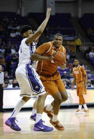 Holmes carries No. 15 Texas past TCU 59-54