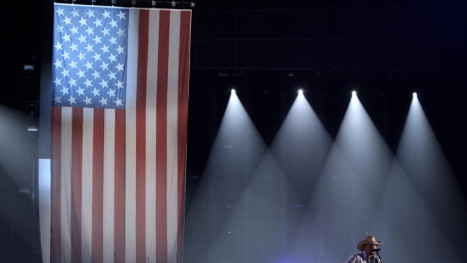 Jason Aldean performs during the opening of the 46th Annual Country Music Awards at the Bridgestone Arena on Thursday, Nov. 1, 2012, in Nashville, Tenn. (Photo by Wayde Payne/Invision/AP)