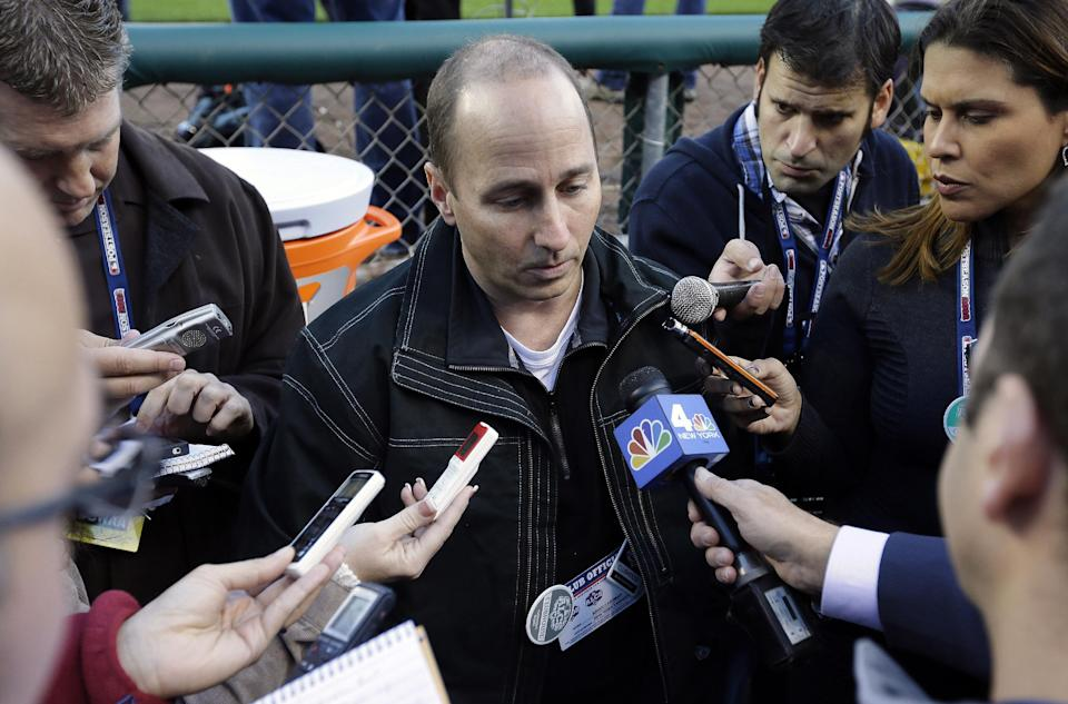 New York Yankees general manager Brian Cashman talks to the media before Game 3 of the American League championship series against the Detroit Tigers Tuesday, Oct. 16, 2012, in Detroit. (AP Photo/Matt Slocum)