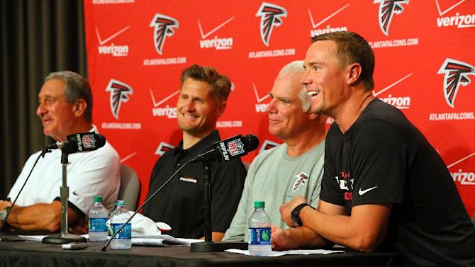 Atlanta Falcons' owner Arthur Blank, left, general manager Thomas Dimitroff, second from left, head coach Mike Smith, second from right, and quarterback Matt Ryan are all smiles during a press conference at NFL football training camp Thursday, July 25, 2013 in Flowery Branch, Ga. Ryan and the Falcons have agreed to terms on a five-year contract extension on Thursday. (AP Photo/Atlanta Journal-Constitution, Curtis Compton ) MARIETTA DAILY OUT; GWINNETT DAILY POST OUT; LOCAL TV OUT; WXIA-TV OUT; WGCL-TV OUT