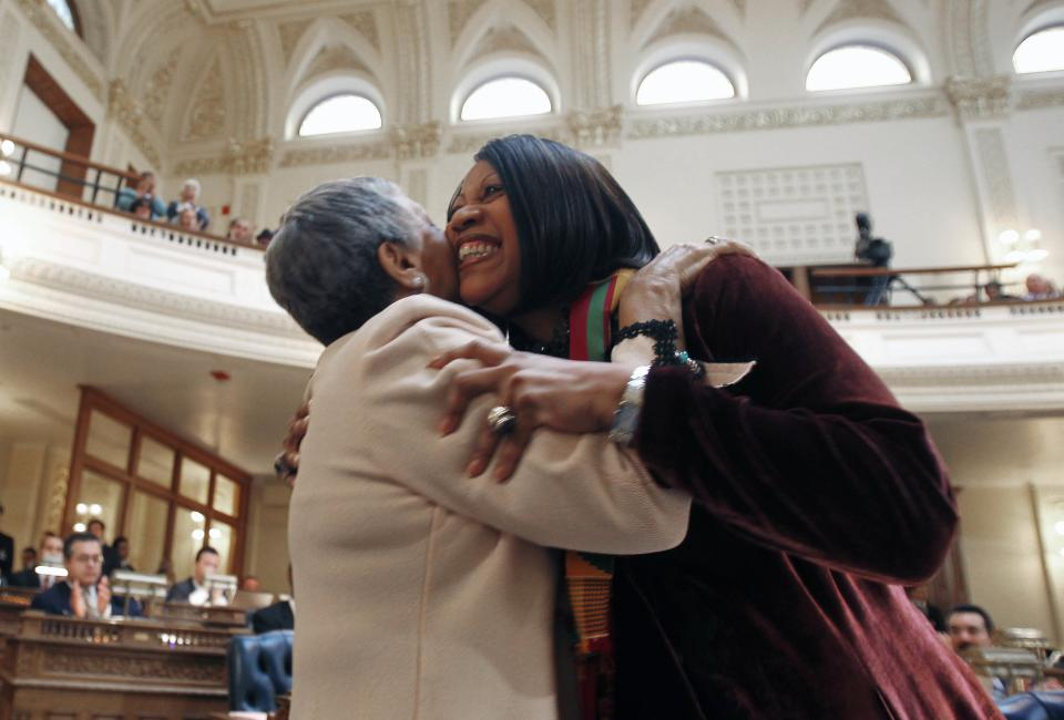Assemblywoman Bonnie Watson Coleman, left, D-Mercer, and Assembly Speaker Sheila Oliver D-Essex embrace after Oliver spoke on behalf of passing the bill sponsored by Rep. Gusciora legalizing same-sex marriages, at the State House in Trenton, N.J., Thursday, Feb. 16, 2012. (AP Photo/Rich Schultz)