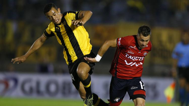 Piriz from Uruguay's Penarol and Vargas from Bolivia's club Jorge Wilsterman compete for the ball during their Copa Sudamericana soccer match in Montevideo