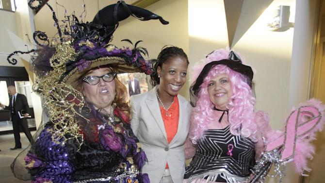 This Oct. 2, 2012, photo, shows Utah Republican candidate Mia Love posing with two performers before a radio debate with incumbent Democratic Rep. Jim Matheson at the KSL broadcast center, in Salt Lake City.  If elected in Utah's redrawn 4th District, Love would be the first black, Republican woman elected to Congress. On the road to possibly becoming the first black Republican woman elected to Congress, Love made a brief star turn at the party's convention, touching on a subject she usually downplays: race. (AP Photo/Rick Bowmer)