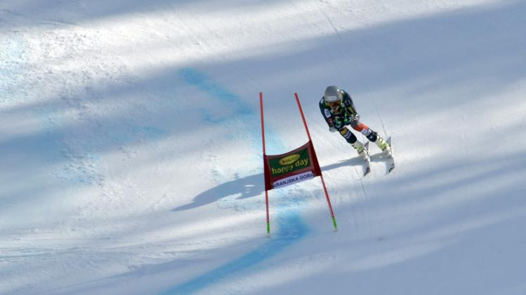 Ted Ligety of the U.S. clears a gate during the second run of the Alpine Skiing World Cup men's giant slalom ski race in Kranjska Gora