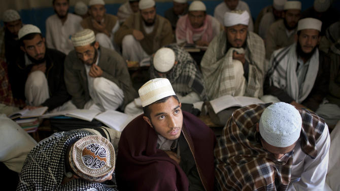 In this Thursday, Nov. 15, 2012 photo, students attend classes at the Jamia Darul Quran madrassa in Mingora, Swat Valley, Pakistan. Unlike many of the madrassas or religious schools in Pakistan that teach a strict and rigid interpretation of Islam that limits education for girls, this madrassa supports education for girls, but segregated. ( AP Photo/Anja Niedringhaus)