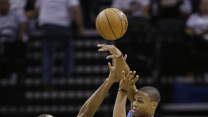 Oklahoma Thunder's Russell Westbrook, right, passes over San Antonio Spurs' Tim Duncan, center and Tony Parker, left, of France, during the second quarter of an NBA basketball game, Thursday, Nov. 1, 2012, in San Antonio. (AP Photo/Eric Gay)