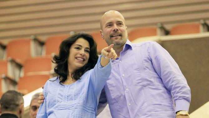 "Gerardo Hernandez, one of so-called ""Cuban Five"", hugs his wife Adriana Perez during the National Assembly in Havana"