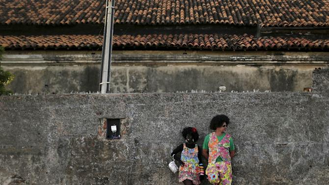 """Revellers attend an annual block party known as """"Eu Acho e pouco"""" (I think it is little) one of the many carnival parties to take place in the neighbourhoods of Olinda"""