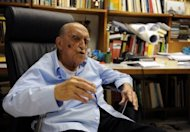 Brazilian architect Oscar Niemeyer speaks to AFP during an interview for his 102nd birthday, in his studio in Rio de Janeiro in 2009. Brazil on Thursday mourned Niemeyer as tributes poured in from around the world eulogizing a towering figure of modern architecture.
