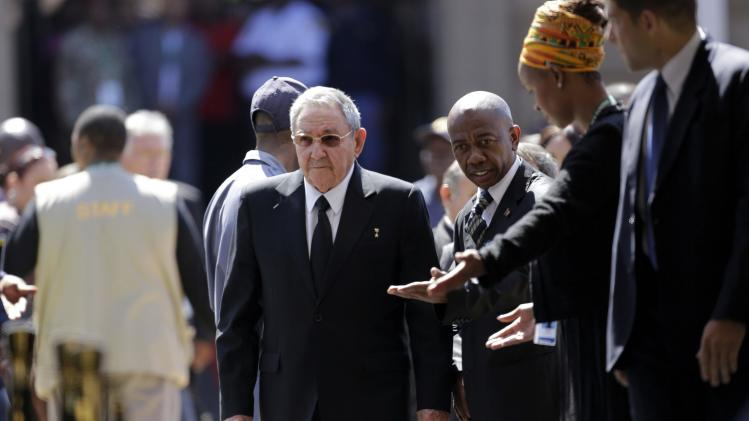 Cuba's President Raul Castro arrives to pay his respects to former South African President Nelson Mandela as Mandela lies in state for the second day at the Union Buildings in Pretoria