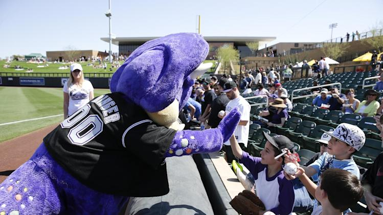 "Colorado Rockies mascot ""Dinger"" greets fans during a spring training baseball game against the Los Angeles Angels in Scottsdale, Ariz., Friday, March 7, 2014. (AP Photo/Chris Carlson)"