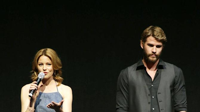 """Elizabeth Banks and Liam Hemsworth, cast members in the upcoming film """"The Hunger Games: Catching Fire""""  at Lionsgate Presentation at 2013 CinemaCon, on Thursday, April, 18th, 2013 in Las Vegas. (Photo by Eric Charbonneau/Invision for Lionsgate/AP Images)"""
