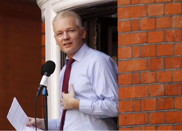 FILE - This Aug. 19, 2012 file photo shows WikiLeaks founder Julian Assange making a statement to the media and supporters at a window of Ecuadorian Embassy in central London. Lawyers for Assange argu