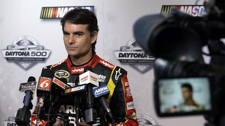Jeff Gordon speaks with reporters during NASCAR media day at Daytona International Speedway, Thursday, Feb. 14, 2013, in Daytona Beach, Fla. (AP Photo/John Raoux)