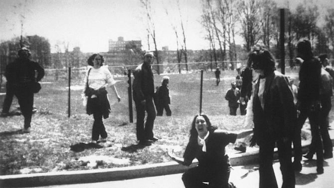 FILE - This is a May 4, 1970 file photo of  Mary Ann Vecchio as she  gestures and screams as she kneels by the body of a student lying face down on the campus of Kent State University, Kent, Ohio . National Guardsmen had fired into a crowd of demonstrators, killing four. (AP Photo/John Filo, File)