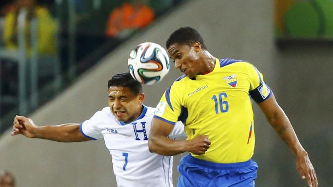 Izaguirre of Honduras fights for the ball with Ecuador's Valencia during their 2014 World Cup Group E soccer match at the Baixada arena in Curitiba
