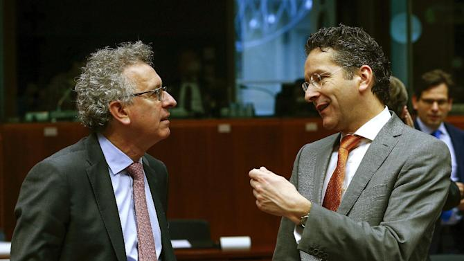 Luxembourg's Finance Minister Pierre Gramegna talks with Dutch Finance Minister and Eurogroup President Jeroen Dijsselbloem during a European Union finance ministers meeting in Brussels