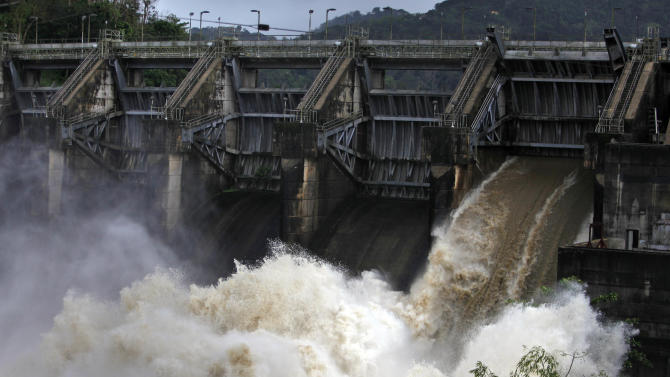 Water rushes through an open bay at the Carraizo Dam to release water left by a passing storm in Trujillo Alto, Puerto Rico, Saturday, Aug. 23, 2014. A tropical depression formed over the Turks and Caicos Islands on Saturday as it headed toward the Bahamas and dumped heavy rains on parts of Puerto Rico and the Dominican Republic, according to the U.S. Hurricane Center. (AP Photo/Ricardo Arduengo)