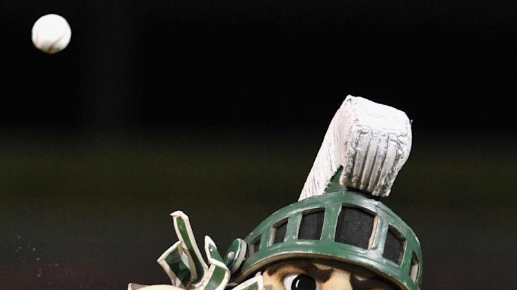 "The Michigan State University mascot ""Sparty"" throws out the ceremonial first pitch before a baseball game between the Houston Astros and the Chicago Cubs at Wrigley Field in Chicago, Monday, Oct. 1, 2012. (AP Photo/Paul Beaty)"