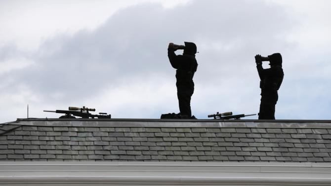 File photo of members of the U.S. Secret Service standing atop the West Wing of the White House in Washington