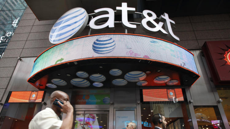AT&T posts 4Q profit, higher revenue