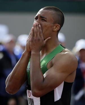 Ashton Eaton reacts after the 1500m during the decathlon competition at the U.S. Olympic Track and Field Trials Saturday, June 23, 2012, in Eugene, Ore. Eaton finished the decathlon with a new world record. (AP Photo/Matt Slocum)
