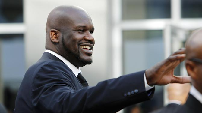 Shaquille O'Neal, former Los Angeles Lakers center and current television analyst, arrives at a memorial service for Jerry Buss, the late Lakers owner who died Monday from cancer complications, Thursday, Feb. 21, 2013, in Los Angeles. (AP Photo/Reed Saxon)