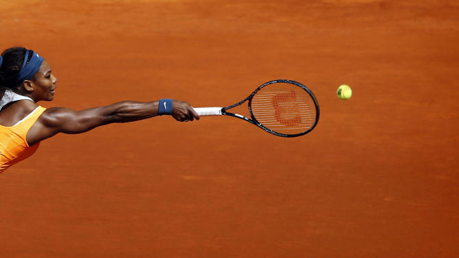 Serena Williams from U.S. returns the ball to Anabel Medina from Spain during the Madrid Open tennis tournament, in Madrid Friday, May 10, 2013. (AP Photo/Daniel Ochoa de Olza)