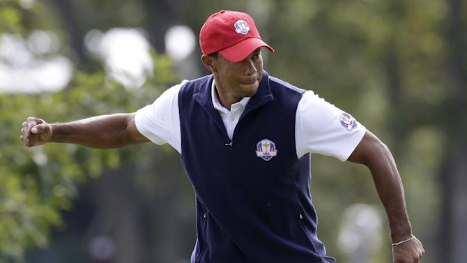 USA's Tiger Woods reacts after making a putt on the first hole during a four-ball match at the Ryder Cup PGA golf tournament Friday, Sept. 28, 2012, at the Medinah Country Club in Medinah, Ill. (AP Photo/Chris Carlson)
