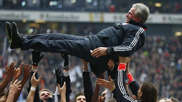 Bayern Munich's players throw coach Jupp Heynckes in the air (Reuters)