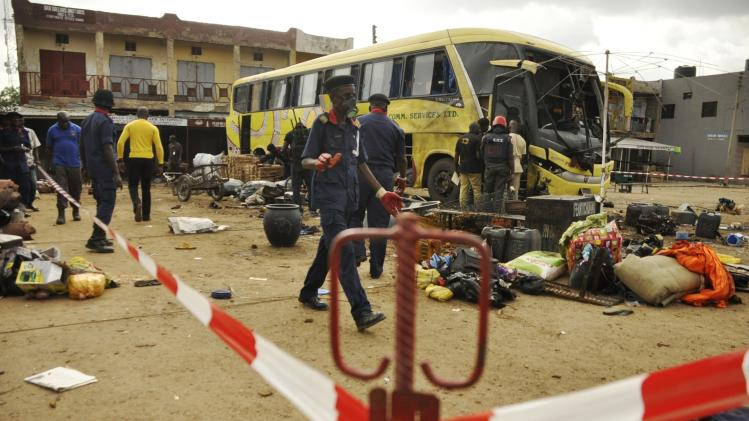 Security personnel comb the scene of a bomb explosion at the Sabon Gari bus park in Kano