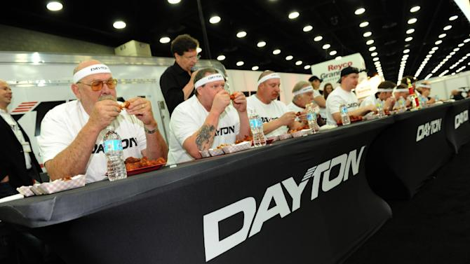 IMAGE DISTRIBUTED FOR BRIDGESTONE - Contestants try to eat three pounds of wings at the Bridgestone buffalo wing eating contest. Roger Errett of Mount Pleasant, Pennsylvania is the lucky winner of a set of ten Dayton™ Commercial Truck Tires at the Mid-America Trucking Show at the Kentucky Expo Center on Friday, March 27, 2015, in Louisville, Ky. (Photo by Joe Imel/Invision for Bridgestone/AP Images)