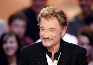 French singer Johnny Hallyday (pictured in 2011) was due to be discharged later Tuesday or on Wednesday from the Caribbean hospital where he was being treated for bronchitis, his manager said. The 69-year-old singer is &quot;doing very well&quot; and is determined to either return home or head to Los Angeles to complete the album he is working on, manager Sebastien Farran told RTL radio
