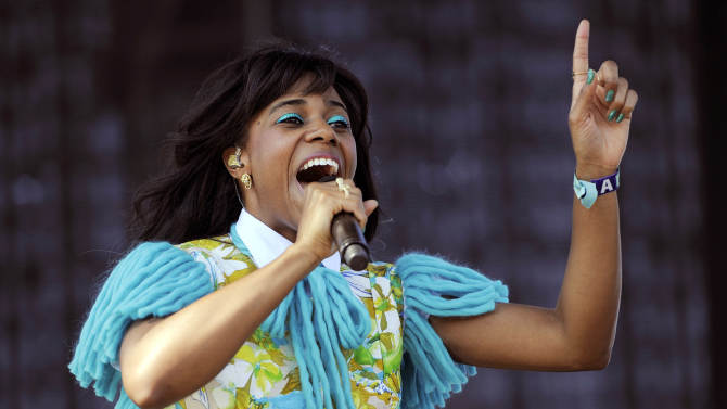 """FILE - In this April 15, 2012 file photo, Santigold performs during the first weekend of the 2012 Coachella Valley Music and Arts Festival in Indio, Calif. Genre-bending singer Santigold released her sophomore album, """"Master of My Make-Believe,"""" last week. It features collaborations with Q-Tip, Diplo, John Hill, Greg Kurstin, David Sitek of TV on the Radio and Nick Zinner of the Yeah Yeah Yeahs. (AP Photo/Chris Pizzello, file)"""