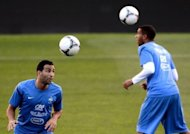 France defender Adil Rami (left) and midfielder Etienne Capoue during a training session on the eve of their World Cup qualifying match against Spain in Madrid on Tuesday. The two sides go into the match level on six points but their preparations have been contrasting